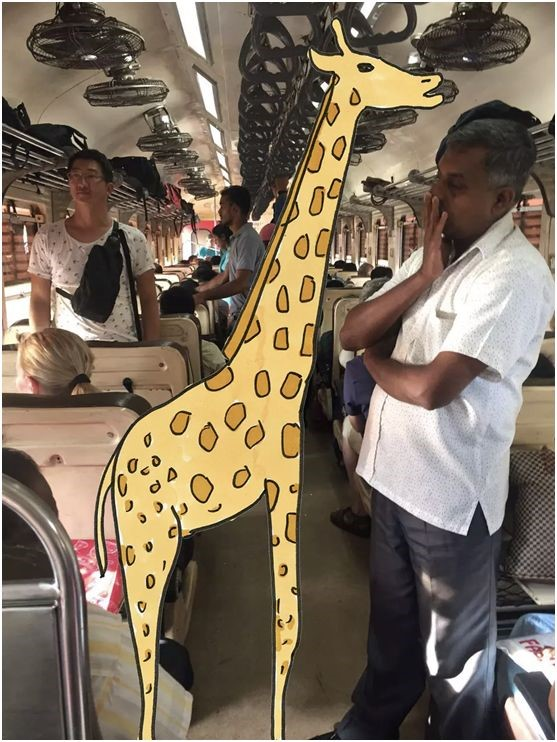 Icy's work--a giraffee drew on the photo of a bus inner
